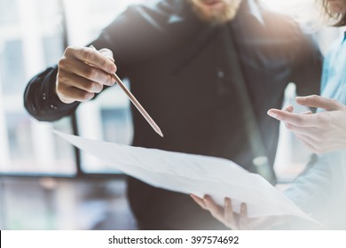 Team job succes.Closeup photo young business managers  working with new startup project in modern office.Analyze document, plans. Holding papers, documents, pencil hands. Horizontal, blurred