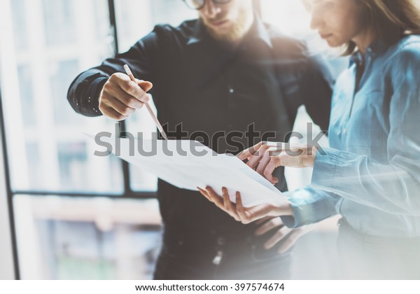 Team job succes.Photo young business managers  working with new startup project in modern office.Analyze document, plans. Holding papers, documents hands. Horizontal, blurred