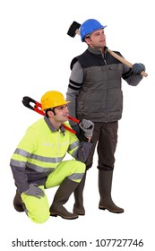 A team of labourers staring off into the distance