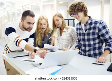 Team leader discussing with male and female coworkers strategy,concept of business plan organizing work of crew correcting mistakes motivate,inspire colleagues working in office on informal meeting