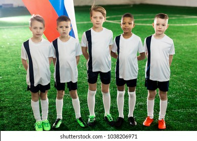 11ea322a564 Team of little football champions of Russia standing on green field