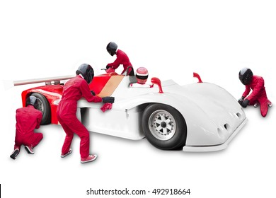 Team maintaining technical service at pit stop for a racing car during competition event isolated on white background