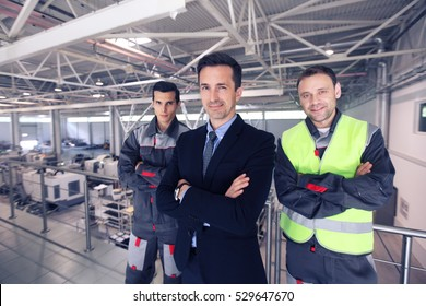 Team of manager and two workers in CNC factory