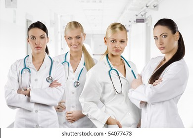 team of medical doctor women with stethoscope looking in camera