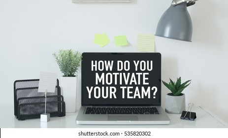 Team motivation leadership business concept with how do you motivate your team question and laptop in office