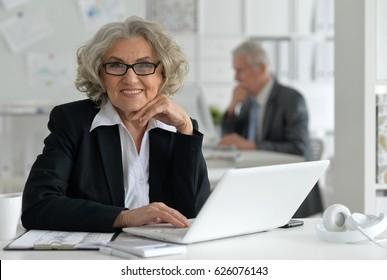 Team of older businessmen working