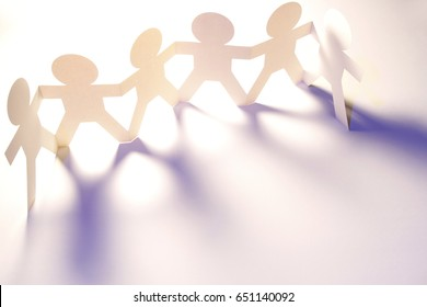 Team of paper chain people holding hands