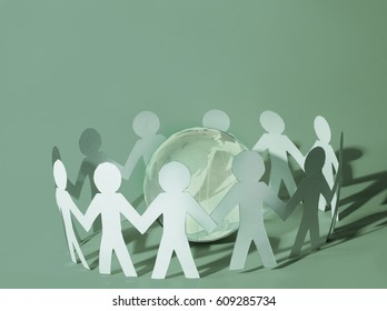 Team of paper doll people holding in hands