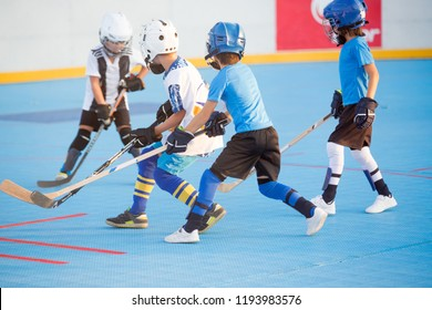 Team players having competitive hockey game outdoors