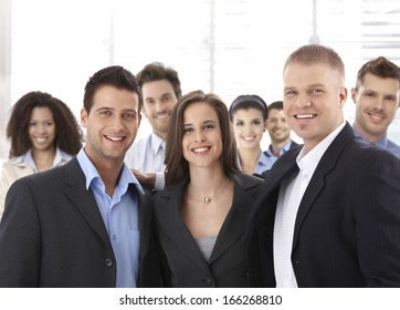 Team portrait of group of happy successful business people smiling.