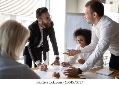 Team of positive friendly diverse colleagues lead by middle eastern ethnicity chief executive officer working together on common business project finances, manage financial plan and paperwork concept