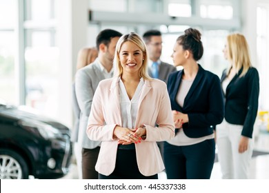 Team of professional salespeople at car dealership