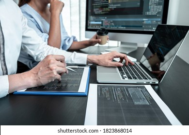Team of Programmer working in software javascript computer in IT office, Writing codes and data code website and coding database technologies to find solution to problem.