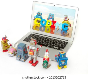 A team of robot toys learn coding on a laptop computer