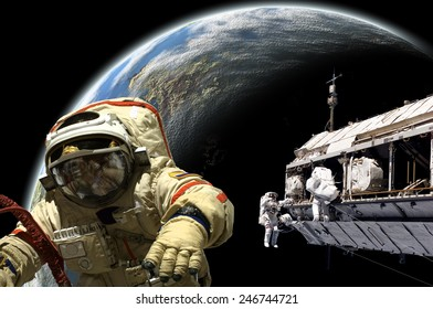 A team of Russian and United States astronauts performing work on a space station while orbiting a large, Earth-like planet. Elements of this image furnished by NASA.