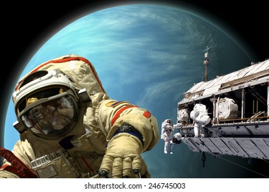 A team of Russian and United States astronauts performing work on a space station while orbiting a large, Alien planet similar to Neptune. Elements of this image furnished by NASA.