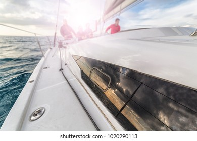 team sailing on sailboat