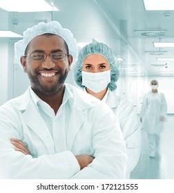 Team of scientists at modern hospital lab