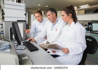 Team of scientists working together at the laboratory