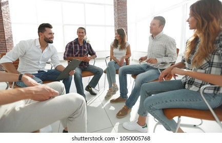 team sitting in a lesson on team building