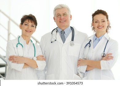 Team of smiling doctors indoors