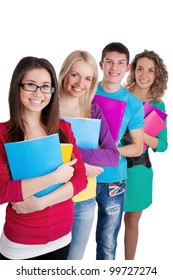 Team of smiling students hold the books in line over a white background