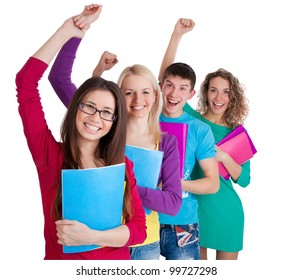 Team of smiling students holding the books in line over a white background