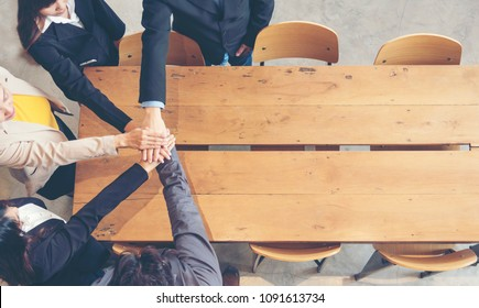 Team Spirit Teamwork Marketing Collaborate in office. Group of people holding hands together showing power. Communications strategy in business office. Copy space Banner Graphic Design Elements use
