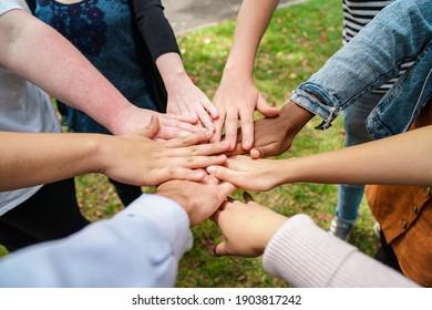 Team Stacking Hands in Unison