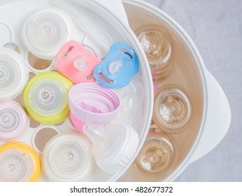 team sterilizer and dryer sterilize baby accessories. Nipple teethers and milk bottles in steam sterilizer and dryer. Steam sterilizer used for sterilize baby accessories by high temperature steam.