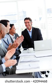 Team of successful business team applauding in a conference. Business concept.