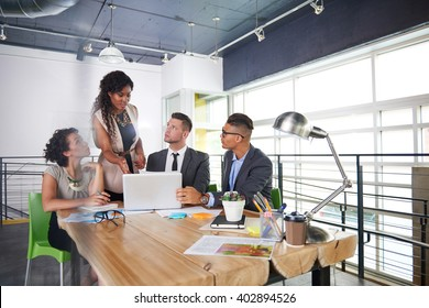 team of successful business people having a meeting in executive sunlit office