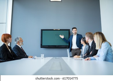 Team of successful business people having a meeting in executive