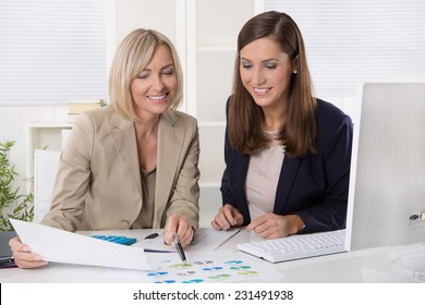 Team of successful businesswoman in the office working in leading positions.