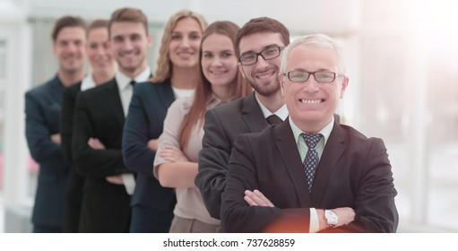 The team of the successful people with their mature boss