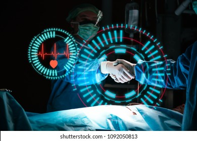 Team surgeon shaking hands with a successful operation in an operating room concept for insurance advertising.hospital brochures.