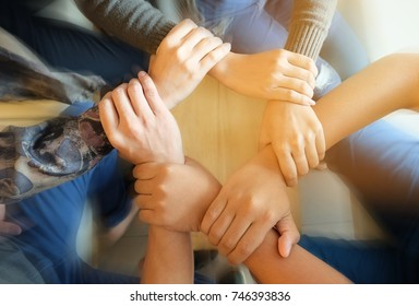 Team Teamwork Join Hands Partnership Concept .Close up top view of young people putting their hands together. Friends with stack of hands showing unity and teamwork.