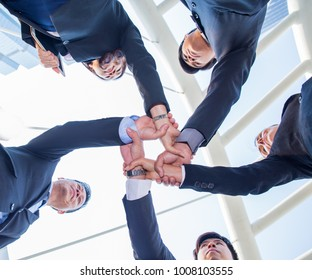 Team Teamwork Togetherness. business people making pile of hands. Collaboration, Key of Success of Team Business Project, Mission Complete Concept.