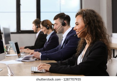 Team of technical support with headsets at workplace