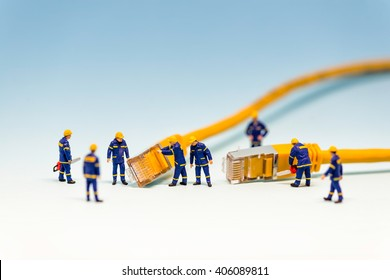 Team of techs with RJ45 network cable. Macro photo