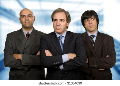 team of three business men standing pensive