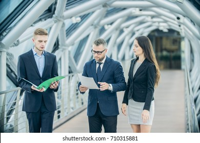 team of three businessmen in business center