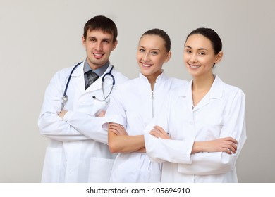 Team of three young doctors in white uniform