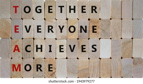 TEAM, together everyone achieves more symbol. Wooden cubes with words 'TEAM, together everyone achieves more'. Beautiful wooden background, copy space. Business, motivational and TEAM concept. - Shutterstock ID 1943979277