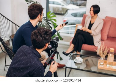 a team of Tv show is recording the chat of a popular nodel with a presenter. close up photo.the creation of talk show