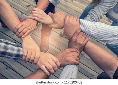 Team of united coworkers their Arm hold  together Power and strong. Hiring and Togetherness Collaboration Concept