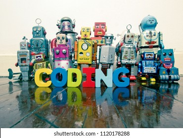 a team of vintage robots on a old wooden floor  with the word CODING