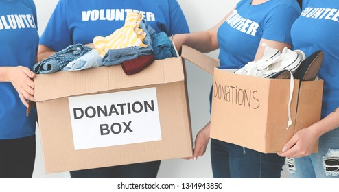 Team of volunteers with donation boxes, closeup