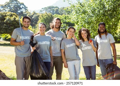 Team of volunteers picking up trash on a sunny day