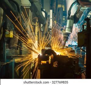 Team welding Robot movement Industrial automotive part in factory